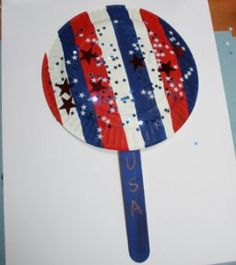 4th of July craft for kids - paper plate, craft stick (or Popsicle stick), glitter, stars, etc.