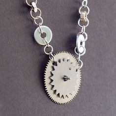 These necklaces are made from silver toned vintage clock gears stacked on  top of each other, and salvaged silver toned vintage nuts and washers. Steampunk Jewelry by Tanith Rohe