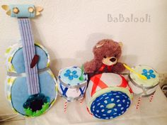 Diaper Cake - The band plays on - Diaper drums and diapr guitar Unique Diaper Cakes, Nappy Cakes, Guitar Diaper Cakes, Gift Cake, Plays, Drums, Baby Shower Gifts, New Baby Products, Band