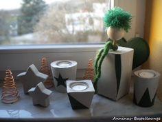 Engel mit verschiedene Deko aus Beton in tannengrün
