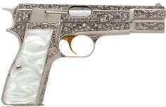 beautifully-engraved-browning-renaissance-hi-power-semi-automatic-pistol-with-gold-plated-trigger.jpg (3000×1952)