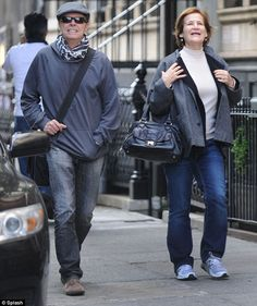 He's back! A grinning David Bowie has a wide smile as he joins a female friend for lunch at Sant Umbroeus in New York