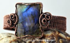 Hand antiqued copper woven wire bracelet featuring large square Labradorite cabochon. Sealed.