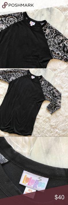 • LuLaRoe • Black Top Black top with stunning print on sleeves LuLaRoe Tops