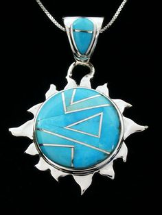 "Designed by Calvin Begay, Inlaid by a Navajo artist    Size: 1 1/2"" Tall w/ bail, 1 1/8"" Wide    Stones: Turquoise    Signed Calvin Begay    Comes With Certificate of Authenticity"