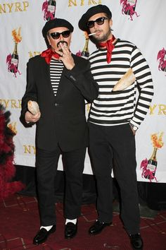 Michael Kors and Derek Blasberg dressed as French men - wearing striped Breton T-shirts and neck scarves and carrying baguettes - to attend Bette Midler's Annual Hulaween Ball in New York