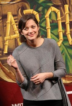 "marion cotillard tries to remember the lyrics as she sings ""je ne regrette rien"" during the roast honouring her as harvard hasty pudding woman of the year 2013 on 31 jan 2013."