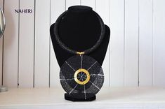 An elegant piece of African beaded necklace, handmade and superbly crafted. * color - black * brass metal decorations * diameter of pendant - 5 inches * neck Width - 16 inches Ships in 7 - 10 business days Made in Kenya African Tribal Jewelry, African Beads Necklace, Beaded Necklace, Necklaces, Rope Jewelry, Brass Metal, Round Pendant, At Least, Pendants