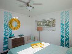 peinture murale blanche et motifs en bleu turquoise dégradé comme accent
