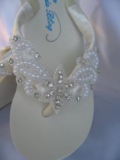 Amazing pair of bridal flip flops. These flip flops will be the perfect compliment to your wedding attire. Beautiful enough to wear with your gown