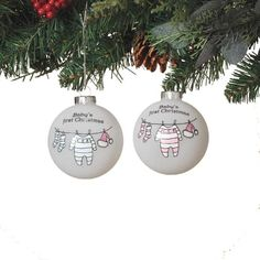 "Baby's First Christmas - Baby Clothes Ornament Size: 3"" Color: White, Pink, Blue Material: Glass Priced individually - choose color Ball ornament with image of baby clothes"
