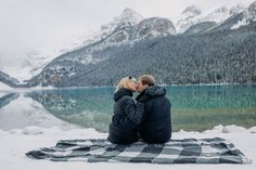 Thinking about visiting Lake Louise in October? See more of this amazing magical snowy Lake Louise engagement session to convince yourself that late fall is the best time to visit the Canadian Rockies! Mountain  engagement photo inspiration. Lake Louise engagement photographer. Best places for mountain engagement photos. Where to do engagement photos in Banff National Park. Rocky Mountain elopement photographer. Lake Louise wedding photographer. Mountain Engagement Photos, Mountain Elopement, Engagement Session, Snowy Mountains, Rocky Mountains, Banff National Park, National Parks, Emerald Lake, Local Photographers