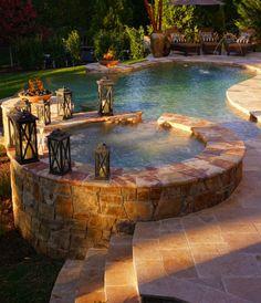 Stone pool and hot tub.