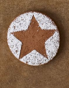 sugar-dusted star cookies    Place a stencil on the cookie and dust with confectioners' sugar or cocoa.