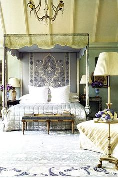 "By Bunny Williams. So many elements to enjoy: mirrored canopy bed (aged glass), tapestry ""headboard"", soft & quiet color palette achieved using several colors, rustic beams on vaulted ceiling, graceful chandelier ...."