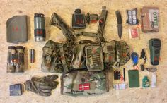 """Contents: 1: WAS Medium utility pouch 1A: Thin Thermo cushion 1B: Nikon 10X42 bino 1C: Leathermann multitool 2: Homemade """"haley strategic"""" bungee utility pouch 2A: Stanley thermo cup (need my coffee...) 3: BFG utility pouch 3A: Laser rangefinder Buchnell 1 mile 3B: Petzl headlampe"""
