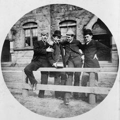 Clearly good friends, this flamboyant quartet from Yale display the popular fashion of the day. Note the news caps on two of the gentlemen and the high top Derby on the others. All display a high button coat with the coat left open to display their waistcoats.