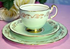 Aynsley pale green and gold teacup, saucer and tea plate trio