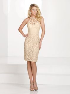 Style No: 115862 Sleeveless hand-beaded lace knee-length sheath, lace illusion high modified halter neckline with beaded collar, sweetheart bodice, center back slit, suitable for wedding guests, formal events, and cocktail parties. Matching shawl included. As shown in Black: Embellish by David Tutera earring style Juliana sold separately. As shown in Champagne: Jeweled Occasions earring style Paige and Embellish [...]