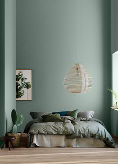 home decor bedroom Modern Earthy Home Decor: Soothing bohemian bedroom with soft pistachio green blue walls and rattan hanging lamp Bedroom Green, Green Rooms, Bedroom Wall Colors, Wall Colours, Green Bedroom Design, Interior Wall Colors, Living Room Colors, Bedroom Ideas Paint, Bedroom With Blue Walls
