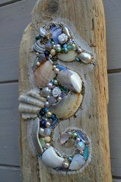Driftwood Seahorse Wall Hanging using shells and pearls, Handmade in Cornwall. Something like this would look good applied directly to a fence postToo cool on driftwood, seahorse bling!This lovely driftwood wall hanging is made using reclaimed driftw Driftwood Seahorse, Seashell Art, Seashell Crafts, Driftwood Art, Seahorse Art, Driftwood Wreath, Driftwood Projects, Driftwood Ideas, Seashell Projects