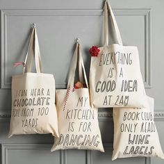 """Joy tote bags: """"I can hear a chocolate foil from 100 yards"""", """"My kitchen is for dancing"""", """"Everything is a good idea at 2 a."""", """"My book club only reads wine labels"""". Diy Tote Bag, Reusable Tote Bags, Sac Tods, Paper Grocery Bags, Diy Sac, Wine Tote, Cotton Bag, Canvas Tote Bags, Canvas Totes"""