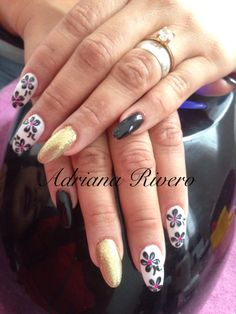 #nails #stiletto #acrylicnails #handpainted #flowers #gelish #glitter #gold #black&white #pink