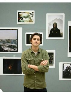 Jackson Harries at his exhibit of photography from refuge camps