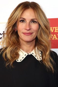Check out 16 of the best celebrity red carpet honey-blonde hair colors, as seen here on Julia Roberts...