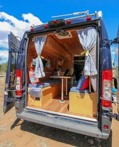 Living and storage ideas in a diy dodge ram promaster van conversion. We love the murphy bed and wor Dodge Camper Van, Dodge Ram Van, Dodge Cummins, Dodge Trucks, Ford Transit Conversion, Camper Van Conversion Diy, Ram Promaster, Van Interior, Camper Interior