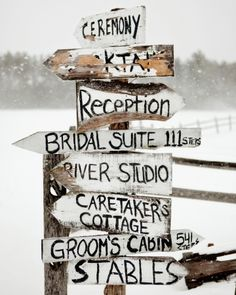 Rustic hand-painted signs directed guests around this farm property