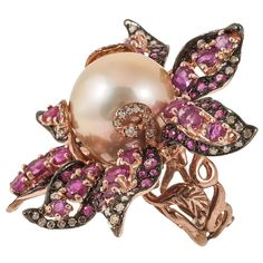 Bloomed Ruby & pink South-Sea Pearl Ring | From a unique collection of vintage cocktail rings at https://www.1stdibs.com/jewelry/rings/cocktail-rings/