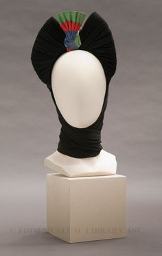 One of those hats that leaves you gasping for air. Like the evil queen in snow white. Beautiful and wicked!