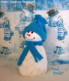 This sweet little snowman likes hanging out with his buddies around the holidays! With his bright turquoise hat and scarf he is ready to hang