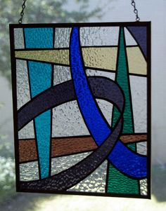 This beautifully designed panels consists of interlocking curves and bands to make a modern design. It is made from cathedral glass with a