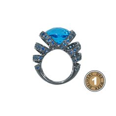 "Plukka - Blue topaz and sapphire ""Ribbon"" ring"