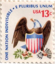 US postage stamp, 13 cents.  One nation indivisible - E Pluribus Unum.  Issued 1 Dec 1975 in Juneau, AK.  Scott catalog 1596.