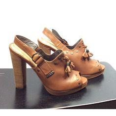 New in Box Brown Cuirass Desir D'Aly Diesel Shoes New in box, no defects. Leather uppers. Sling back strap with double ring closure. Open toe. Tassels in front. Studs around toes and as you slide your foot in. Five inch squared heels. Diesel Shoes Heels