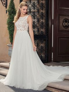 e502a6fd97 The A-line skirt of this wedding dress by Casablanca Bridal features  stretch chiffon under soft tulle allowing for a flattering fit for brides  of every ...