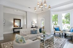Wall color is Abalone by Benjamin Moore.  Beautiful light warm gray that would work with warm or cool accents.