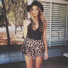 Animal print shorts and black tank top with black hat. Cute summer outfit classy