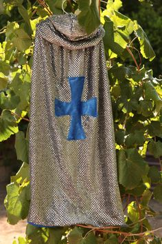 Little Boys will love dressing up as a knight with our handmade Knight /King Hooded Cape. The cape is made from metallic knight chainmail on one