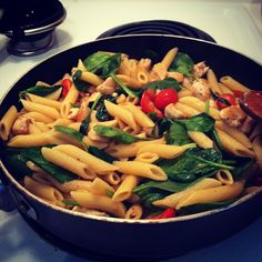Pioneer Woman's Chicken Florentine-Penne, Chicken, Baby Spinach, Grape Tomatoes. Really easy to make.