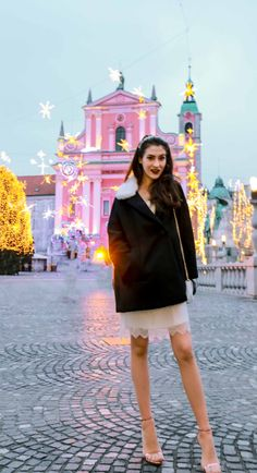 Fashion Blogger Veronika Lipar of Brunette from Wall Street wearing white sequinned dress, short loose black and white coat from Escada, rose gold metallic in high-shine glass sandals from Stuart Weitzman, blue glove, white shoulder bag and tiara for New Year's Eve Party