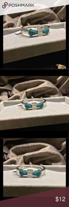 NWT Lia Sophia Teal Bow & Crystal Bracelet Sz M Lia Sophia Silver Bracelet with Teal Bow & Clear Cut Crystals Sz M. Bangle Style, but   Stretches open to put on Lia Sophia Jewelry Bracelets