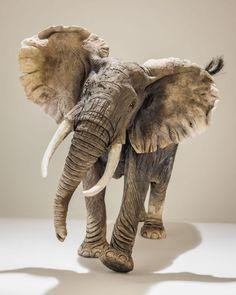 #Ceramic #sculpture by #sculptor Nick Mackman titled: 'African Elephant (Raku fired ceramic Elephant statuette figurine)'. #NickMackman