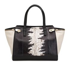 COOL CONTRAST:  BAGS | SALVATORE FERRAGAMO - Black and white calfskin tote with python detail.