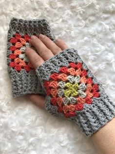 This is a gorgeous Crocheted Ladies Granny Square Wrist Warmers. These are made from the very popular Granny Square pattern. These lovely soft fingerless mi Granny Square Häkelanleitung, Granny Square Crochet Pattern, Crochet Granny, Easy Crochet, Granny Squares, Crochet Gloves Pattern, Knitting Patterns, Crochet Patterns, Crochet Hats