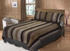The quilt features stripes, plaids and herringbone in a pattern that will surely please the men in your house, from teen to the more mature. #strong #masculine #stripe #bedding #quilt