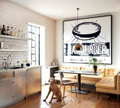 who needs brunch out? so chic, so fun. love the furniture combos and oversized fast food art / domino